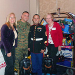 "NEWH President, Two Marines and Andrea Sell (Capri Contractors) At NEWH holiday ""Toys for Tots"" event"