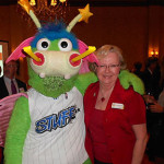 "Orlando Magic mascot ""Stuff"" and Andrea Sell (Capri Contractors) At NAWIC, NAIOP event held at the Orlando Country Club"