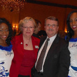 Andrea Sell (Capri Contractors), Jerry Sell (Eden Site Development) between two Orlando Magic Cheerleaders At NAWIC, NAIOP event held at the Orlando Country Club